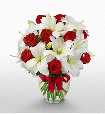 Muğla hediye sevgilime hediye çiçek  1 dal kazablanka 11 adet kırmızı gül vazosu